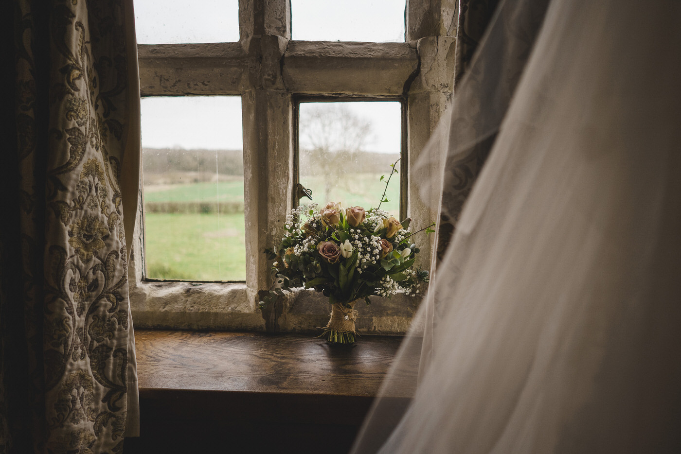Bridal flowers on a window sill at soulton hall in shropshire