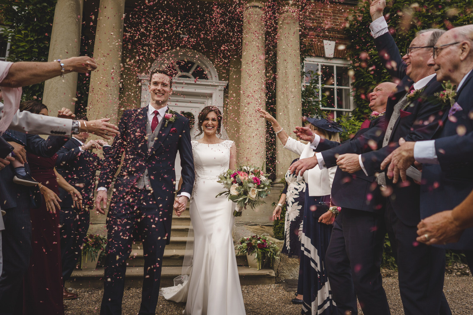 Iscoyd park wedding photographer in Shropshire with guests throwing confetti