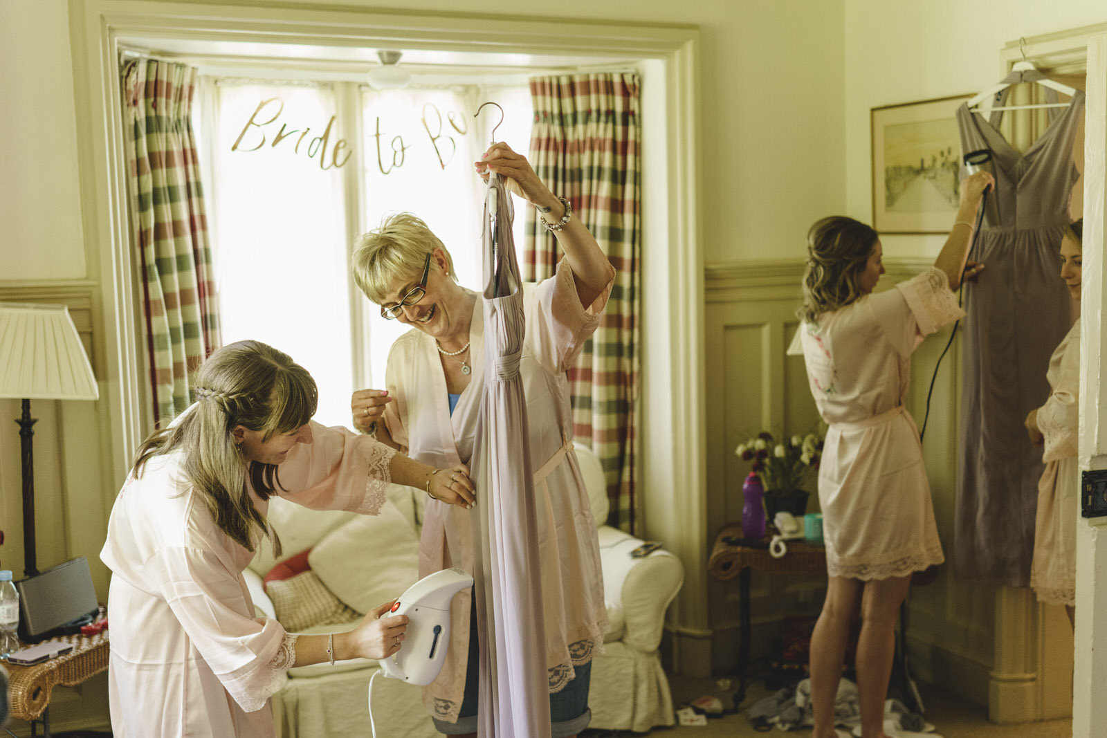 the hanging and ironing of dresses is all part of the day as the wedding preparations start