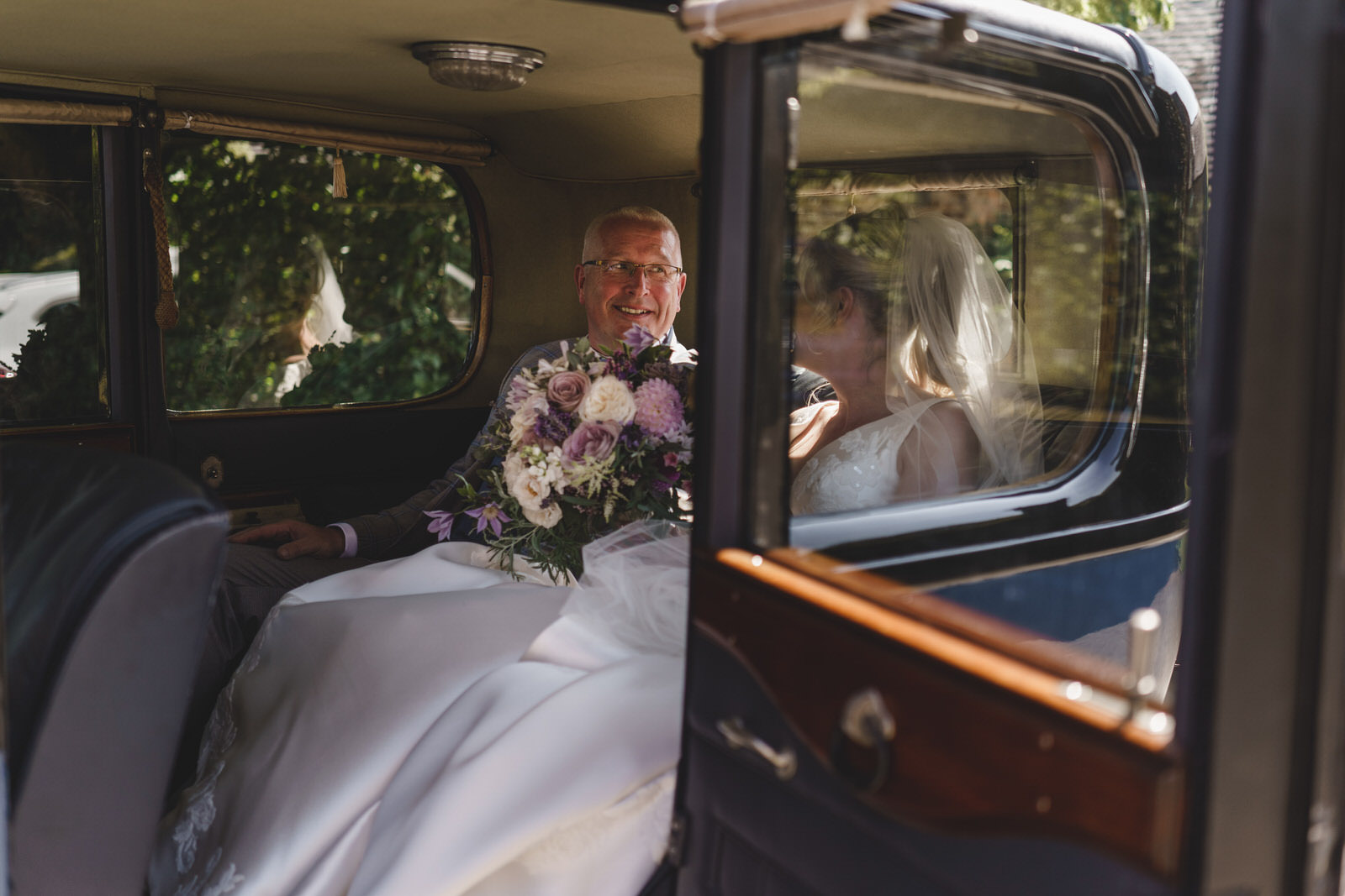 the bride and her Father arrive for the ceremony at combermere abbey