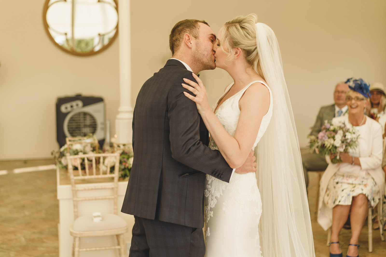 bride and groom share a first kiss at their combermere abbey wedding