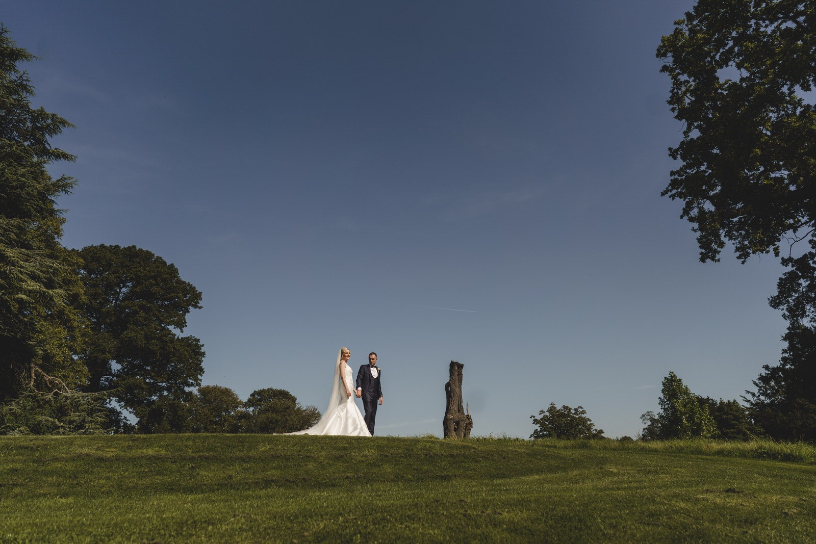 the bride and groom in the beautiful grounds at combermere abbey