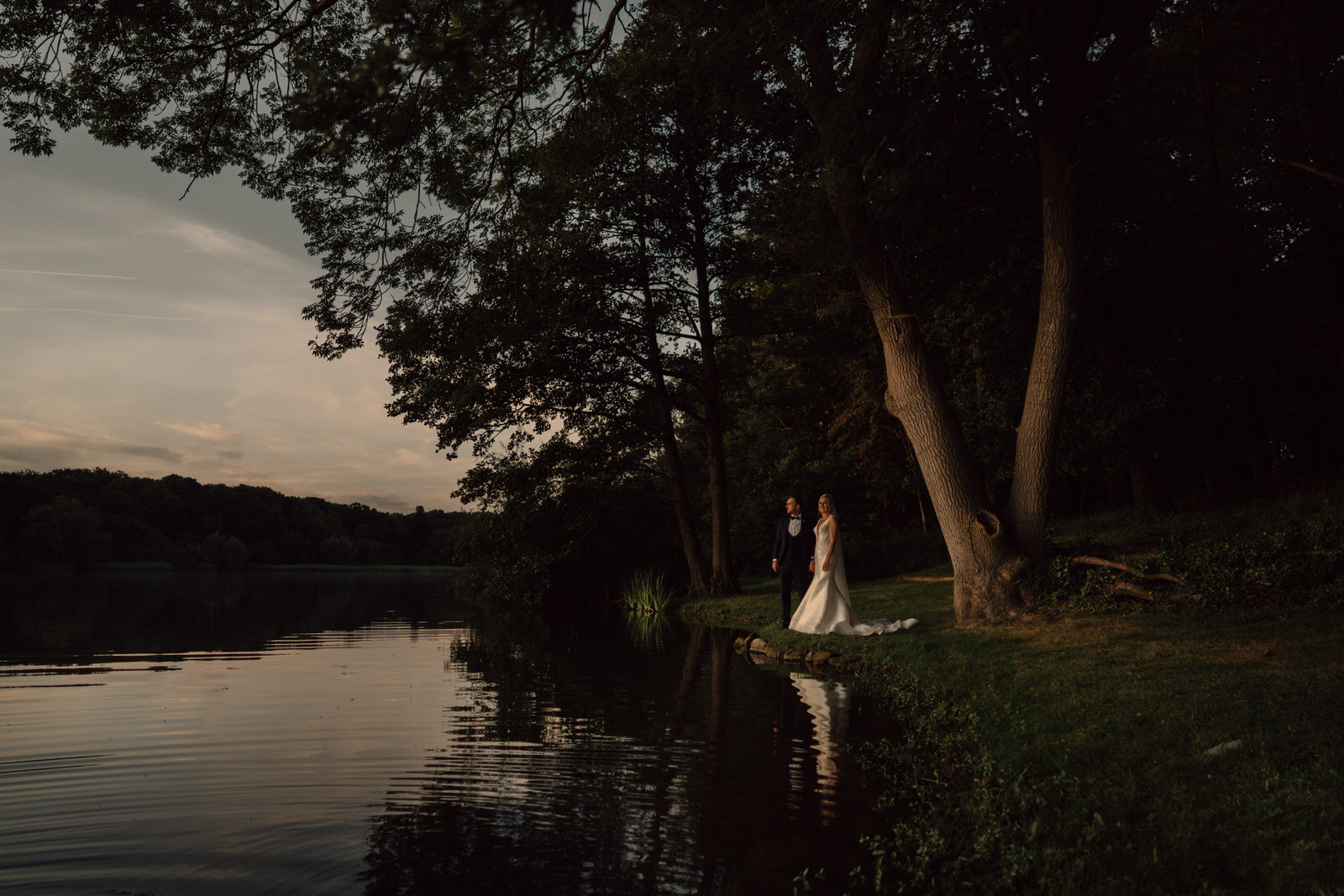 done by the lake at combermere abbey is where the bride and groom stop and take in the view