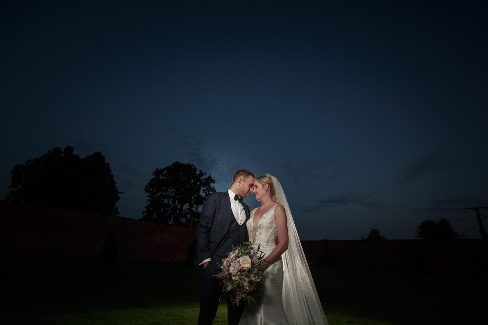 the happy couple at combermere abbey with bouquet