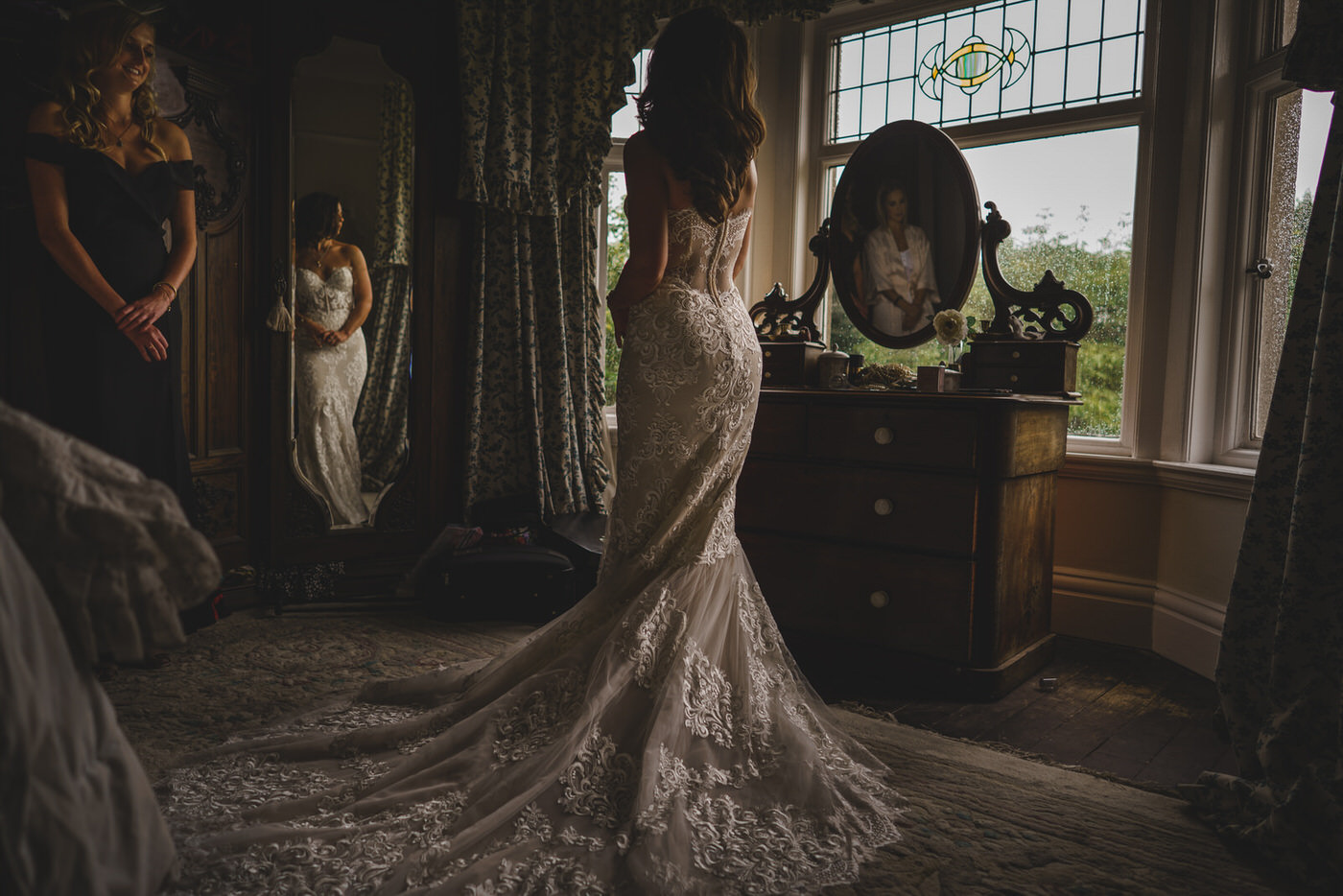 the beautiful bride in her stunning dress showing off the incredible detail