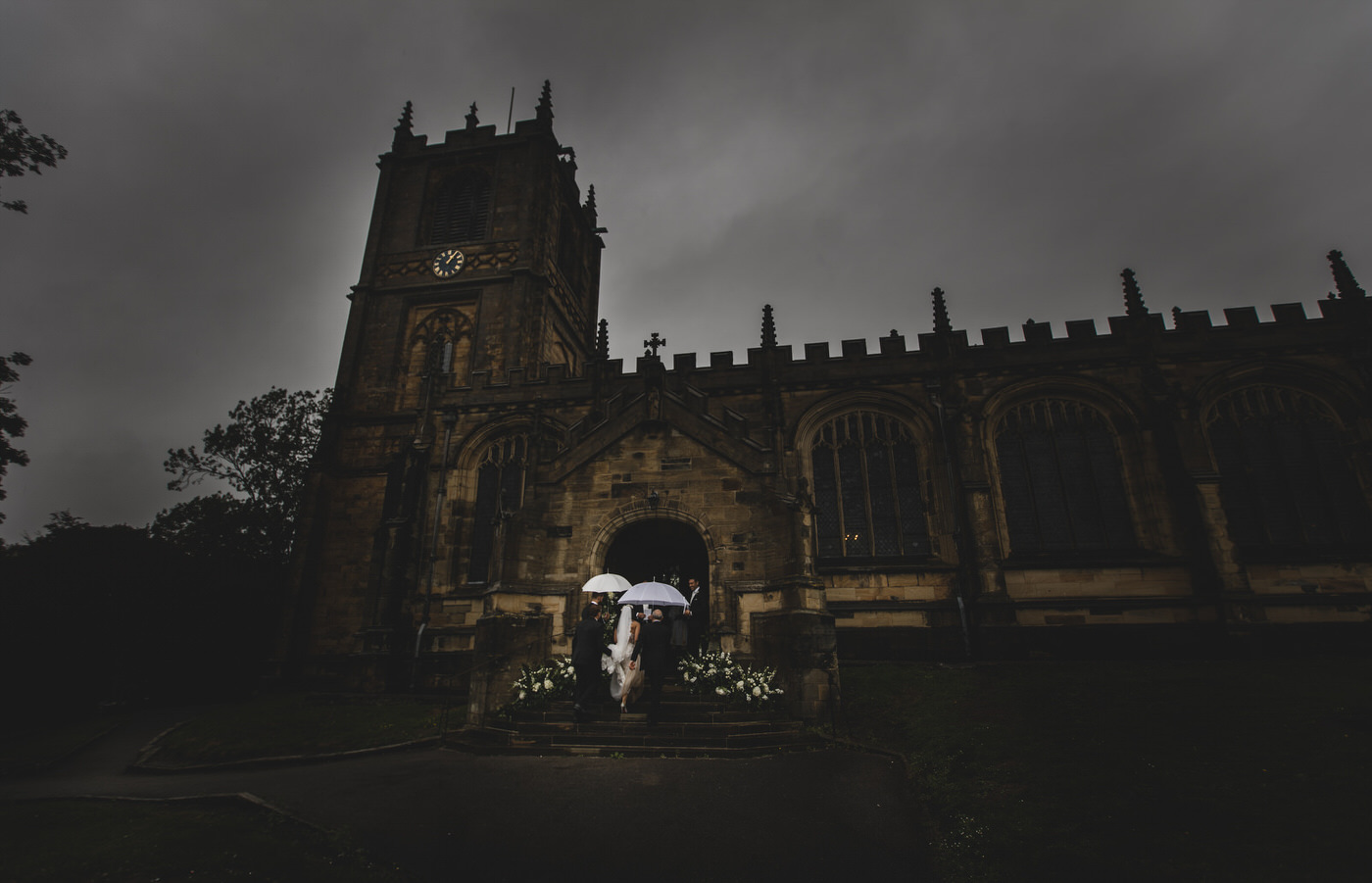 the bride climbs the steps to St Mary's Church in Mold for her wedding ceremony