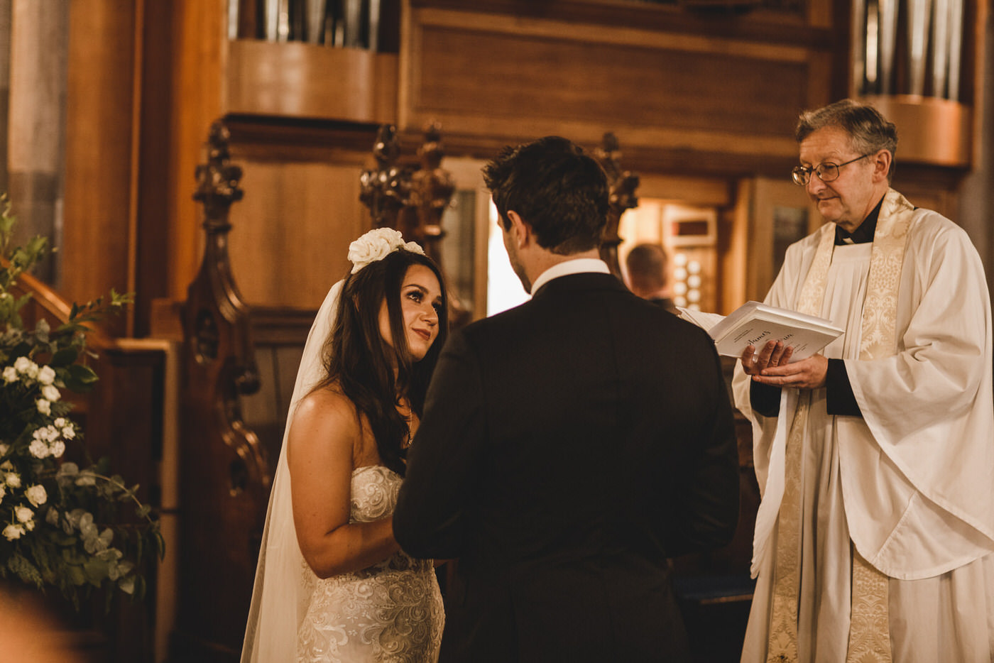 the bride looks on lovingly at her groom as they exchange their vows