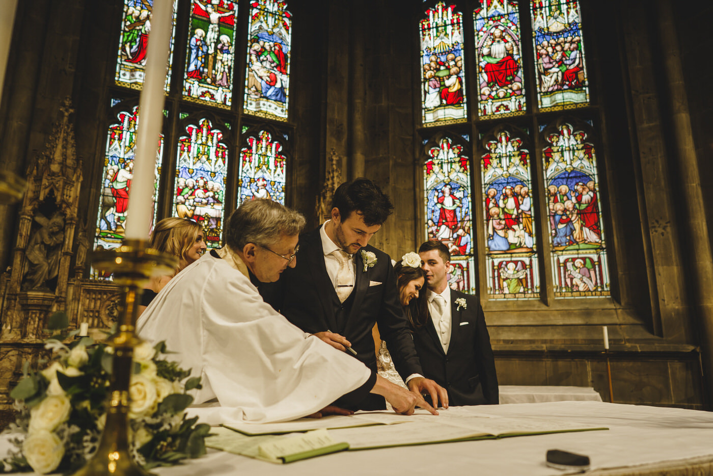 the groom signs the register