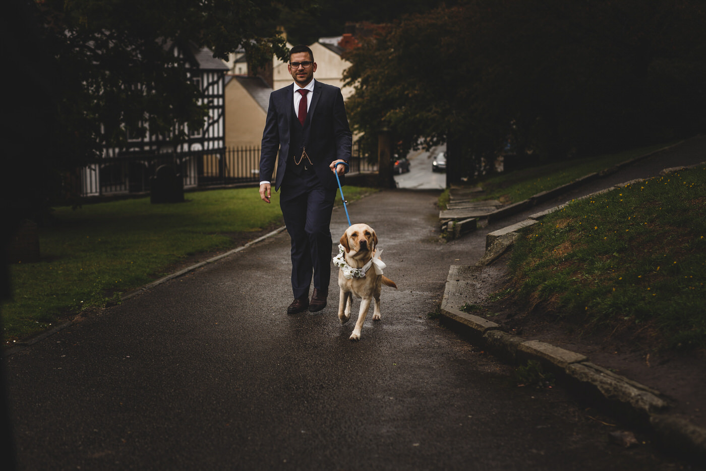 the newlyweds pet Labrador is brought to St Mary's Church