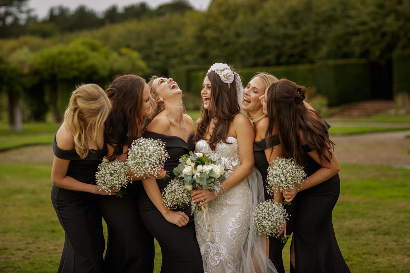the bride and her bridesmaids enjoy a few moments of fun at the wedding reception