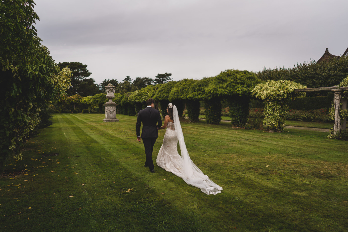 the bride and groom take a few minutes out in the grounds of Thornton Manor