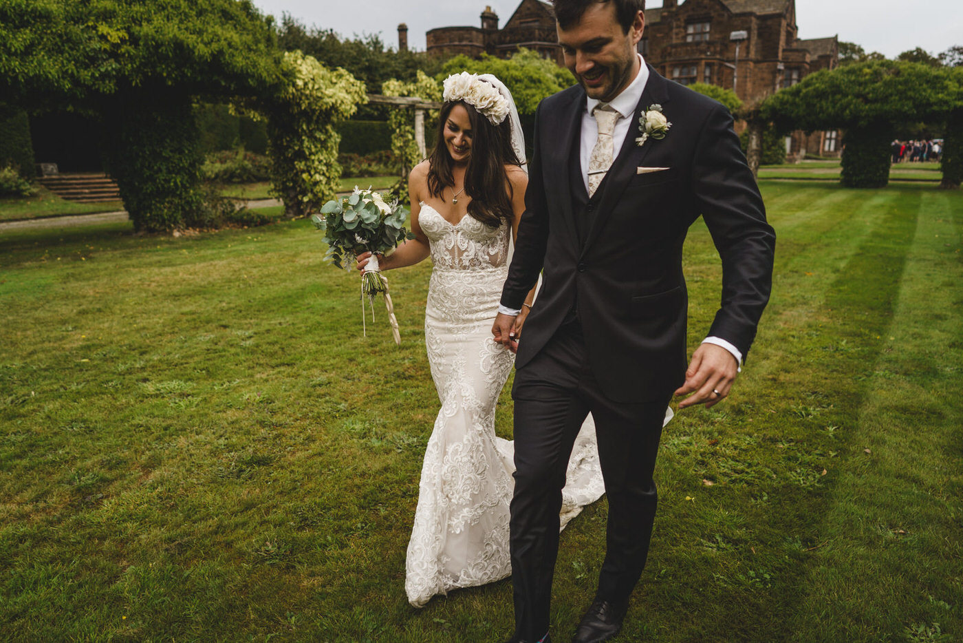 the beautiful bride and her groom taking some time to walk around the wedding venue grounds