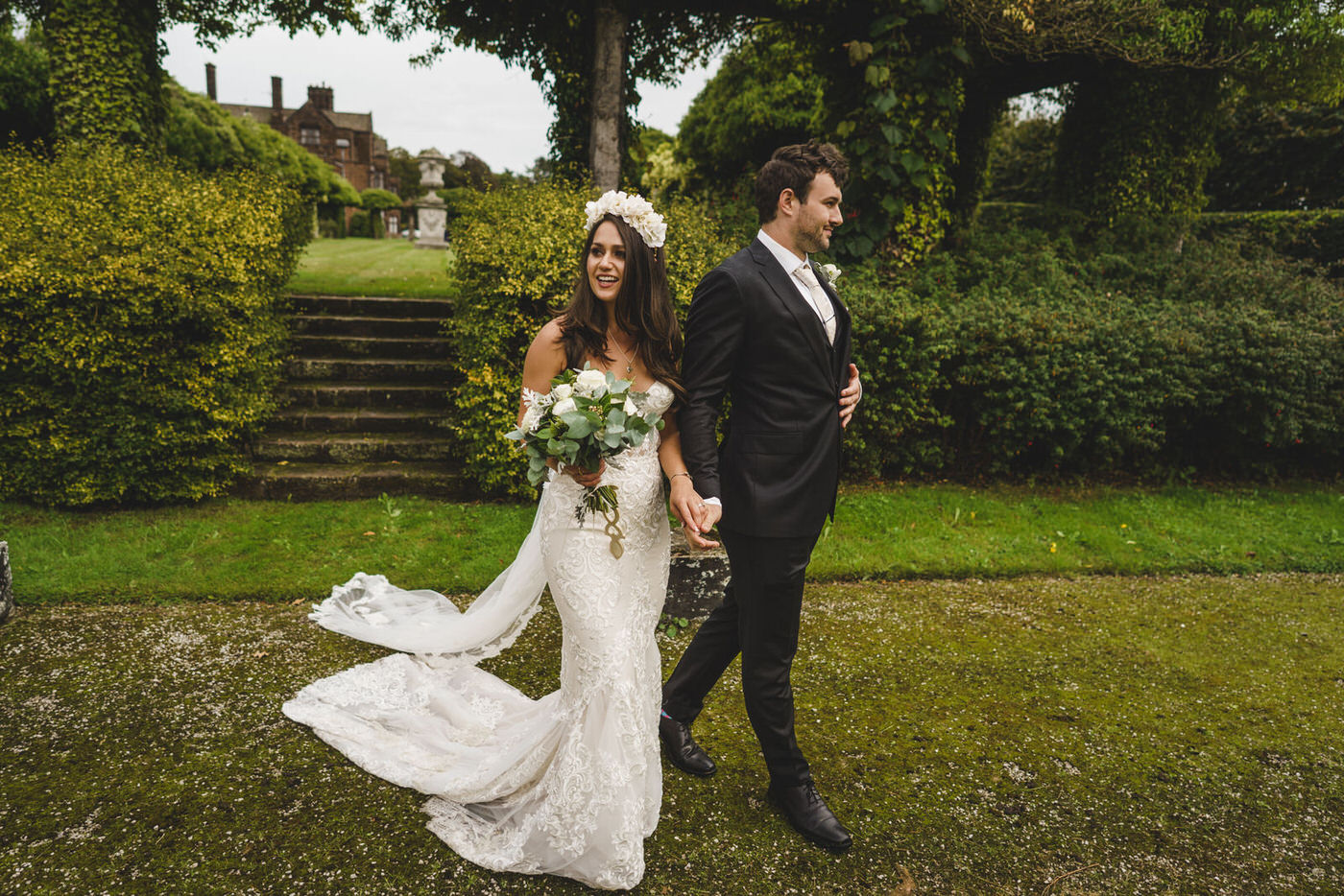 the happy couple take the chance to walk around the grounds of their wedding venue in Liverpool