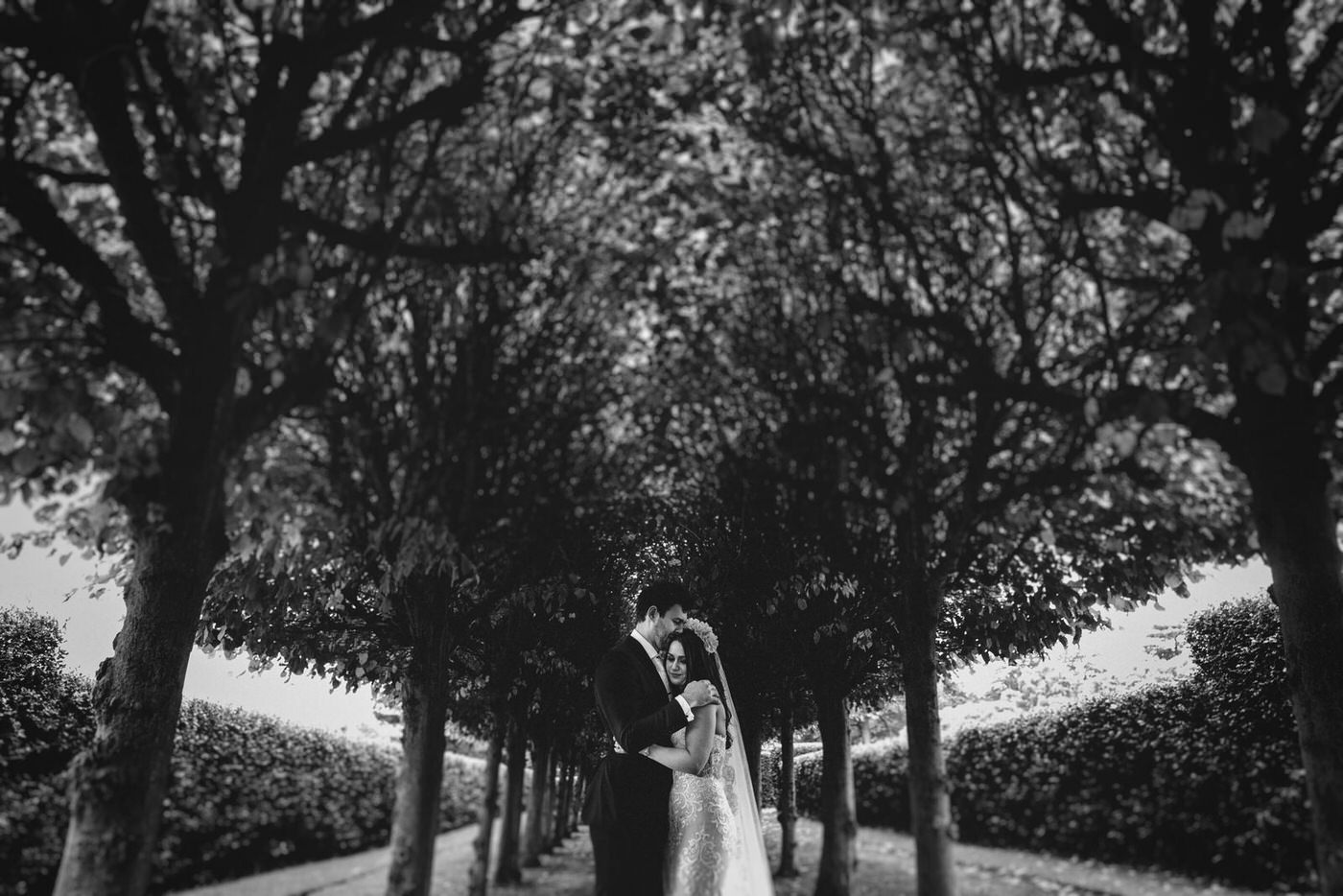 the bride and groom share a beautiful intimate moment underneath the trees at Thornton Manor