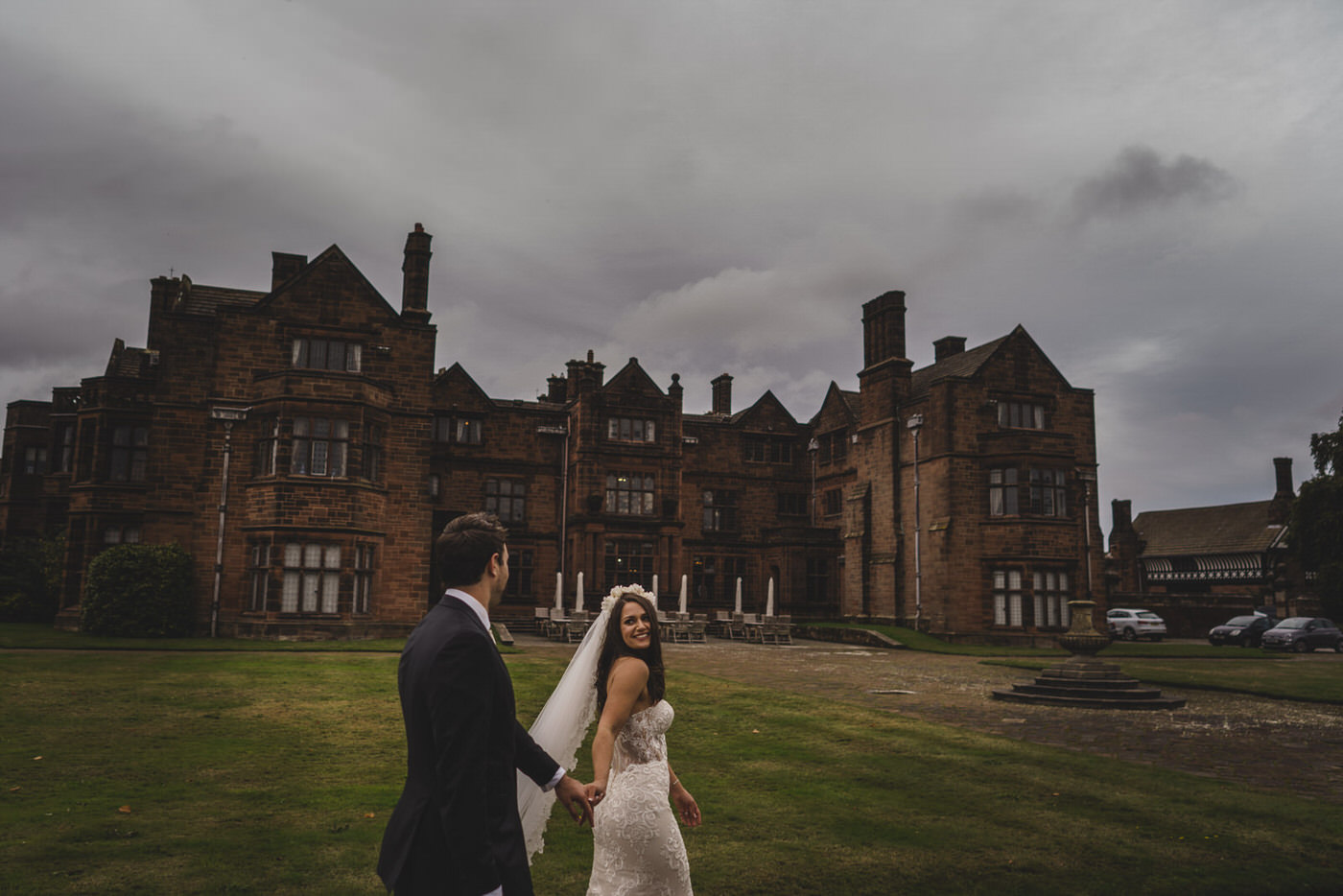 Thornton Manor is the perfect backdrop to the bride and groom as they walk through the gardens