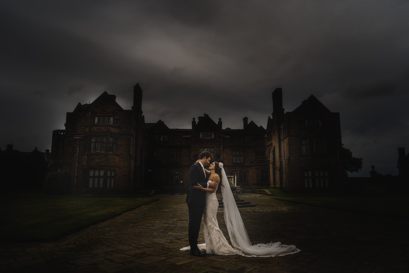 The stunning bride and her groom in front of Thornton Manor