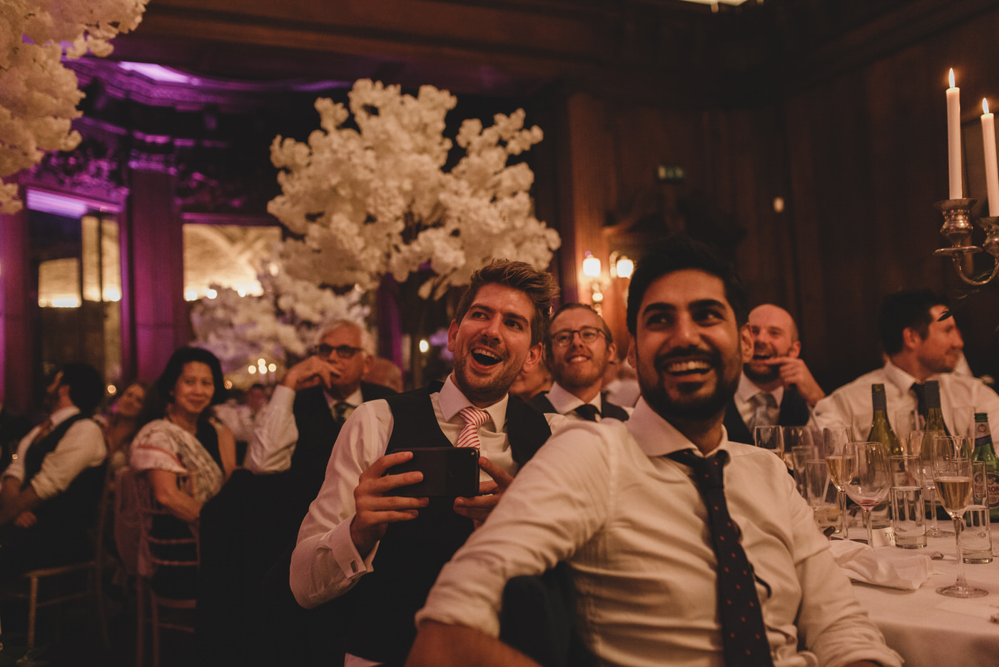 guests are caught laughing during the wedding reception speeches