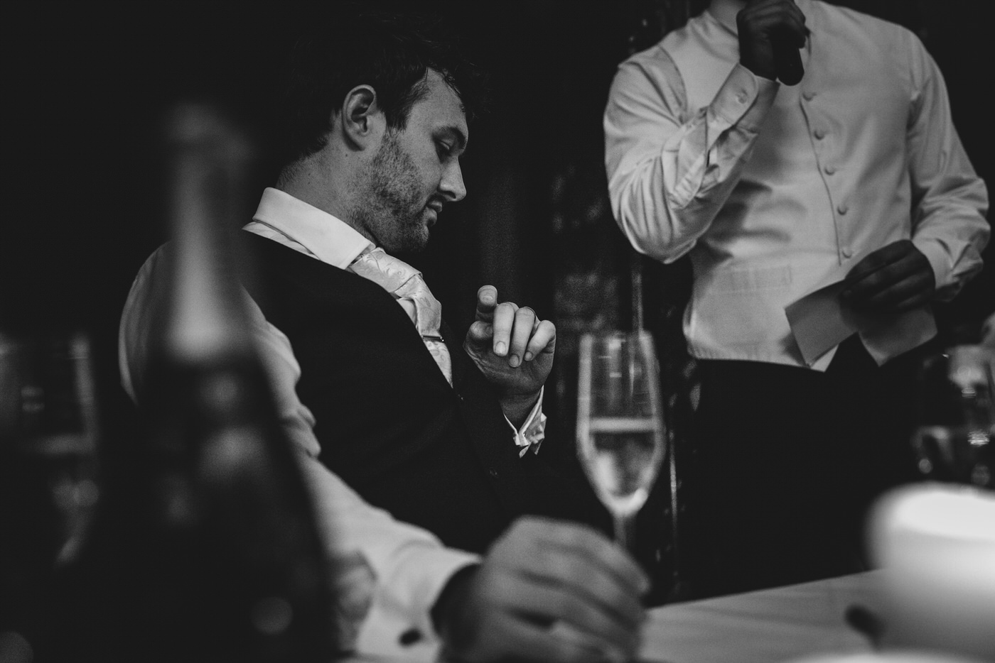 a moment of quiet reflection as the groom listens to his best man's speech