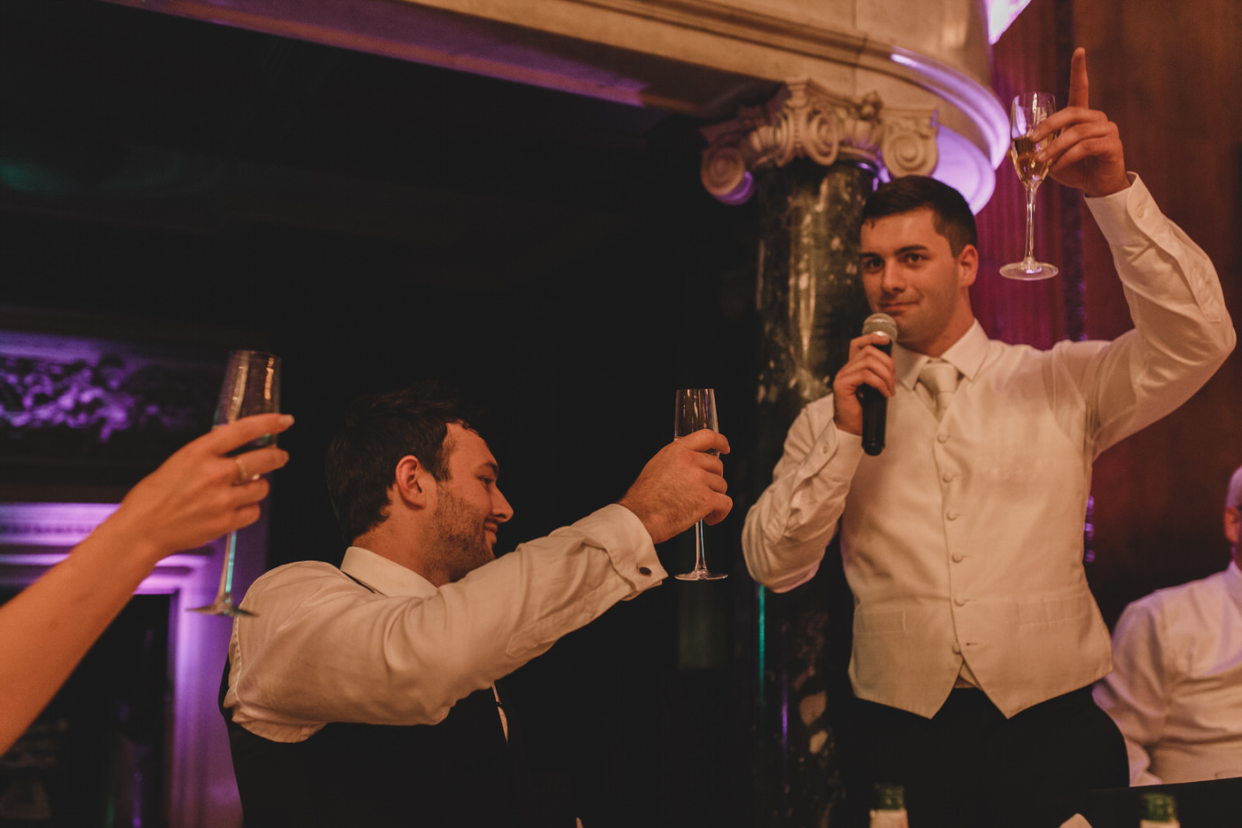 the best man raises a toast to the happy couple