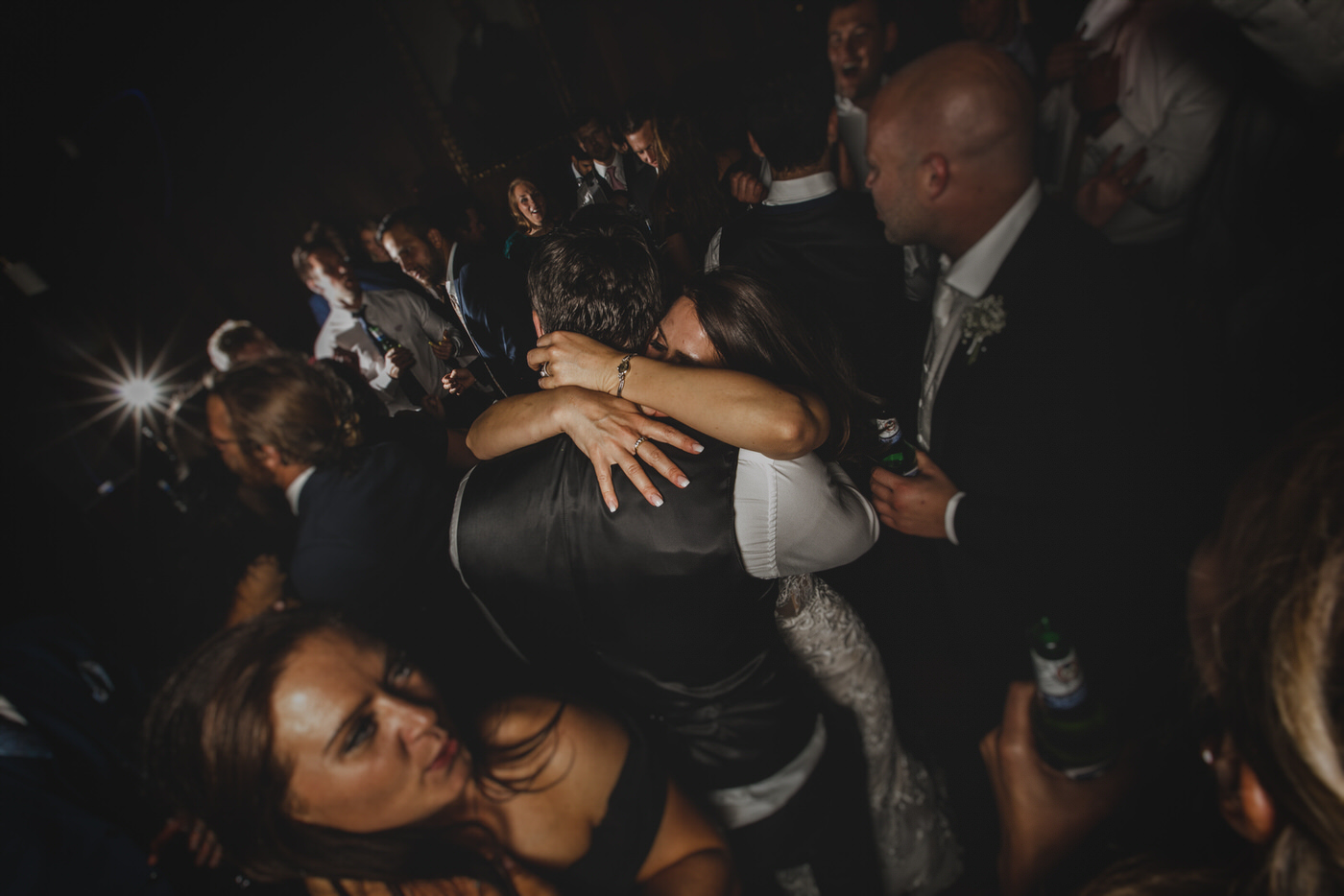 the bride and groom embrace on the dancefloor at Thornton Manor