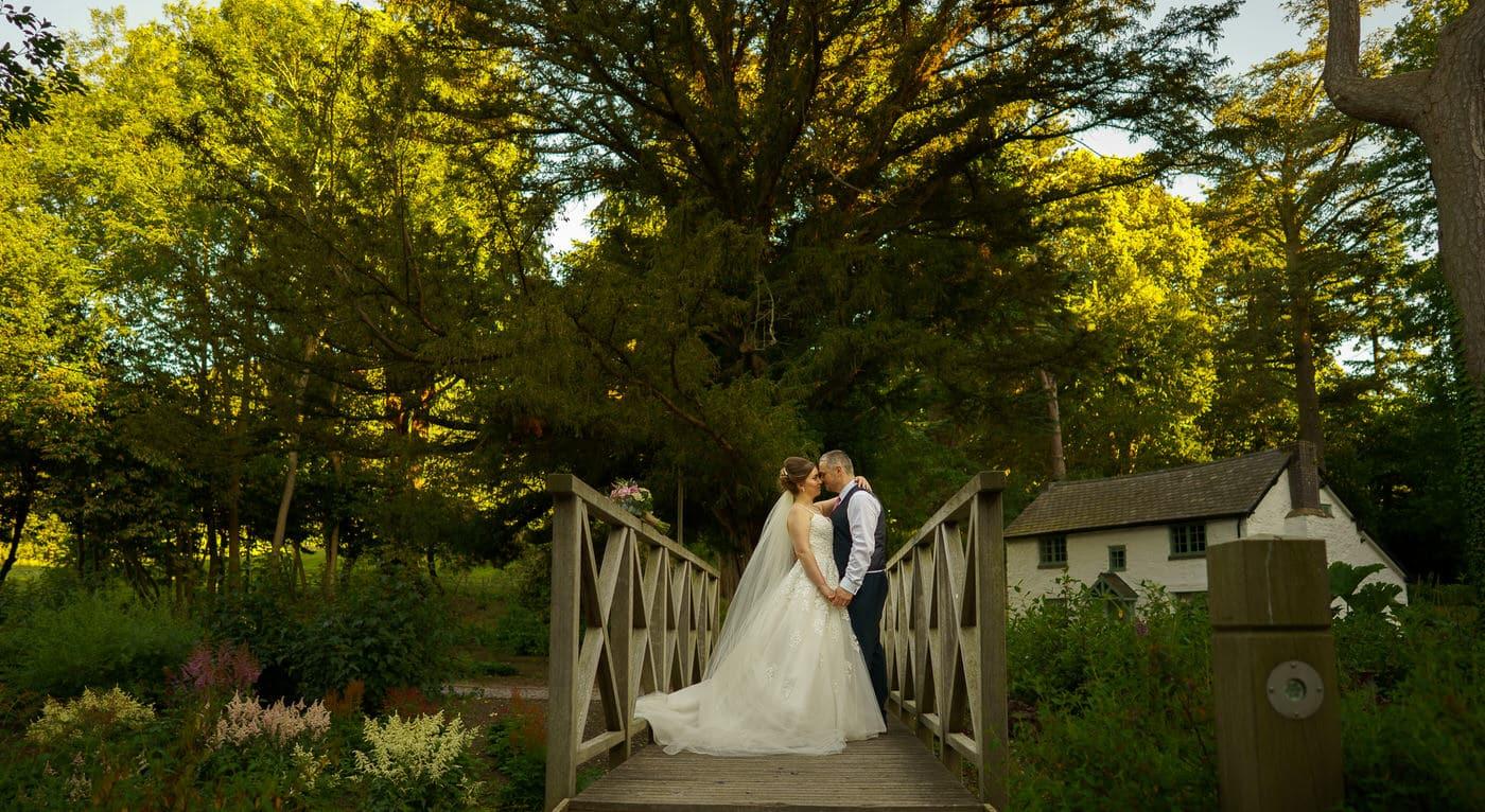 Tyn Dwr Hall Wedding Photographer with bride and groom at their wedding