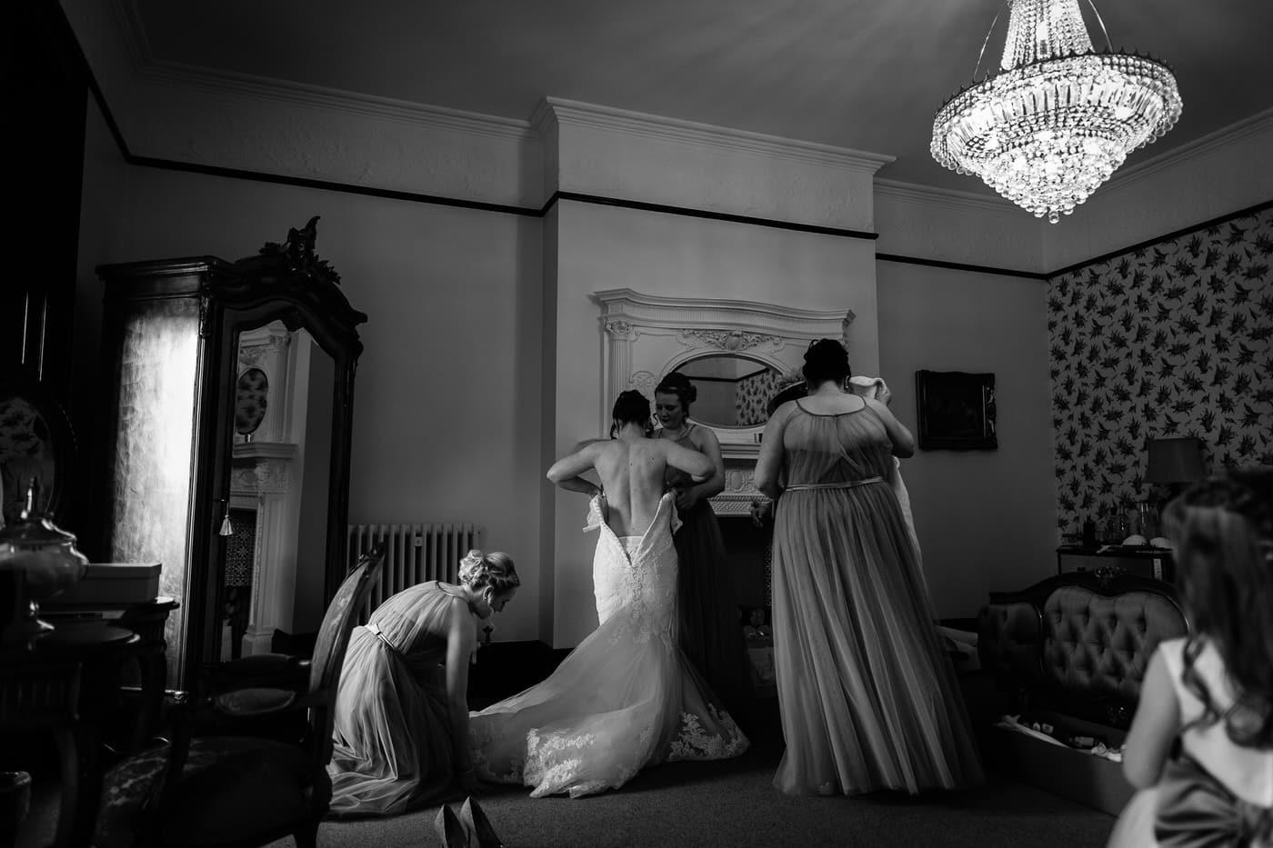 Bride getting her wedding dress on at Tyn Dwr Hall in Llangollen