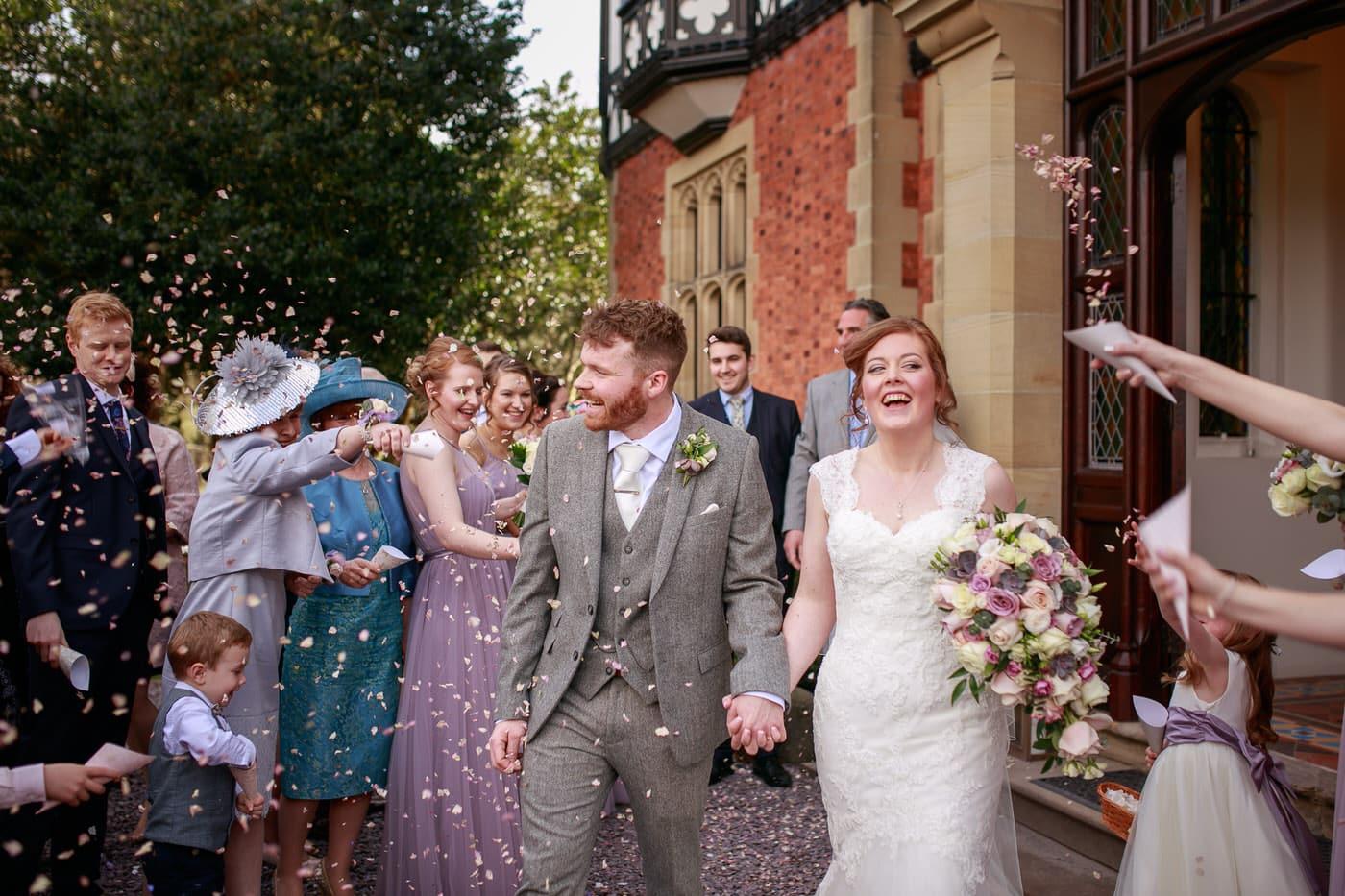 Bride and groom get showered by confetti at Tyn Dwr Hall wedding