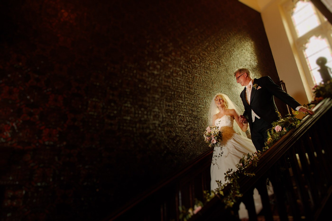 The bride and her Father make their entrance at Tyn Dwr Hall