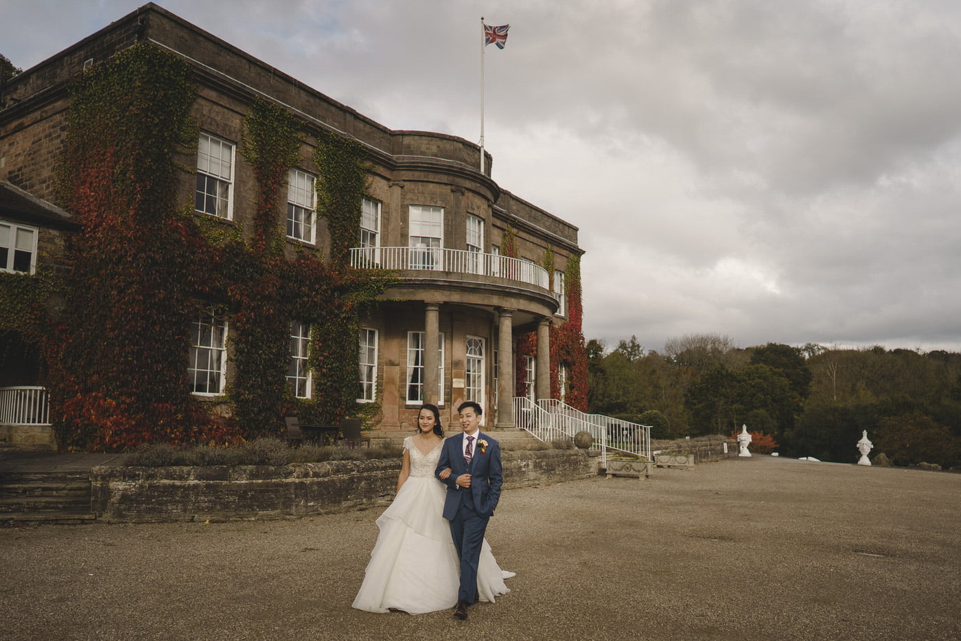 The bride and groom enjoy a walk around Woodhall Hall
