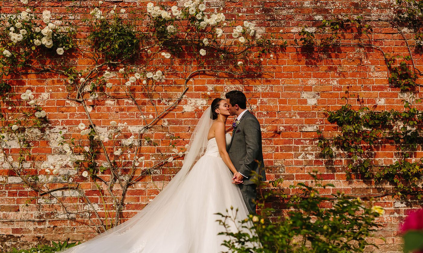 Bride and groom share a kiss at combermere abbey wedding venue