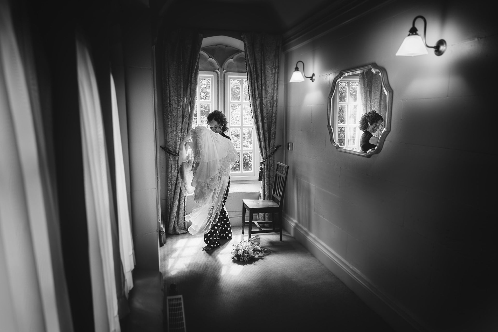 The bride gathers her dress at combermere abbey