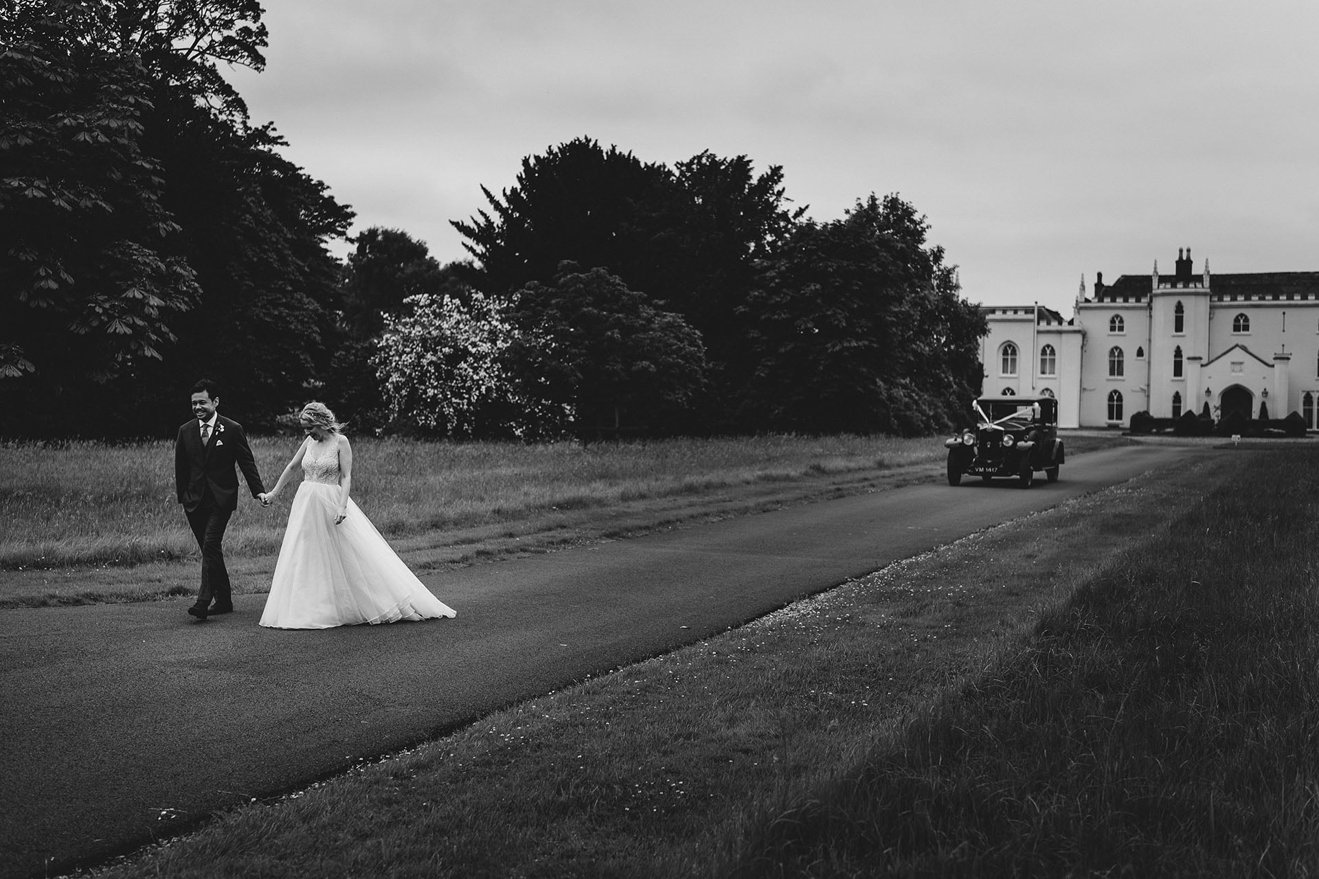 bride and groom take time out at combermere abbey wedding venue on the shropshire and cheshire border
