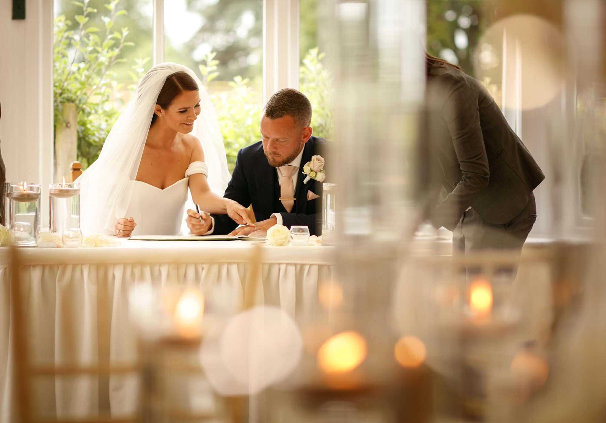 bride and groom signing the register at combermere Abbey in shropshire and cheshire borders