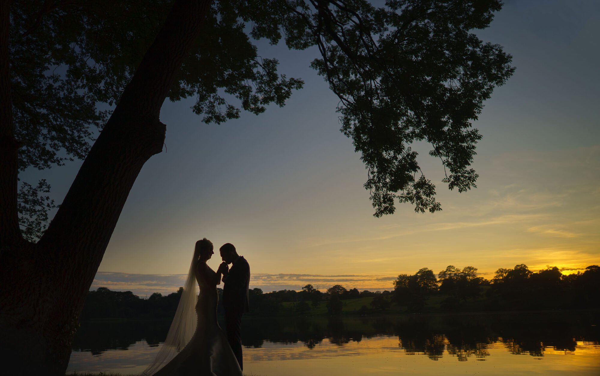 Bride and groom take some time out by combermere